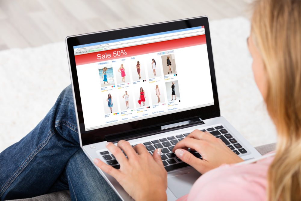 Young Woman Shopping Online On Laptop